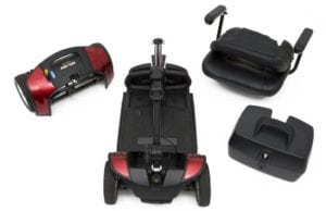 This photo shows a pride mobility scooter broken down into four pieces which makes the reservation experience even simpler for our customers. Make your booking  reservation for you full size or Travel size scooter today.